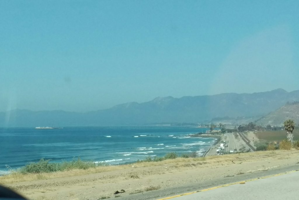 We Didn T Stop But Clearly Saw The Beach As Ped By Sea Was A Spectacular Blue Colour Backed Mountains It Really Dreamy